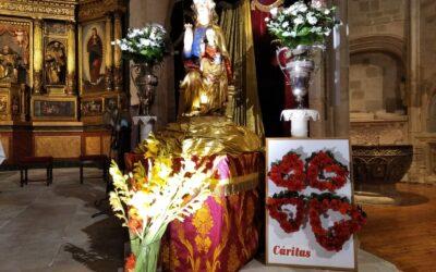 Cáritas participa en la ofrenda floral a la Virgen de las Viñas